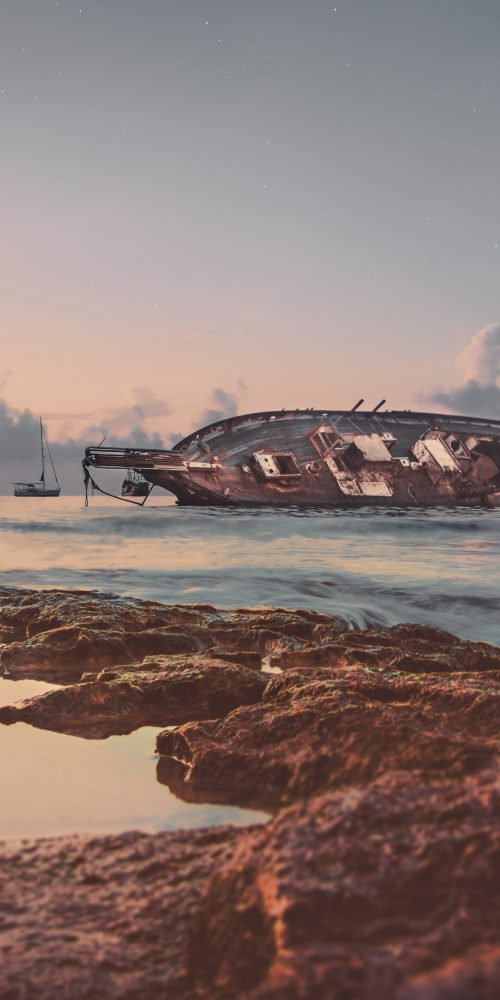 A ship wrecked along a coastline